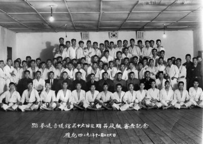 Directors and Chief Instructors of the Korean National Armed Forces pose with students at the Oh Do Kwan after a Taekwon-Do promotion in Korea on November 26, 1960. Second row (L-R): Grand Master Kim Bok Man, third; Colonel Paik Joon Gi, fourth; General Woo Jong Lim, fifth; Colonel Nam Tae Hi, seventh; and Colonel Lee Sang Ku, former Deputy Director of the Korean Central Intelligence Agency (KCIA), ninth.