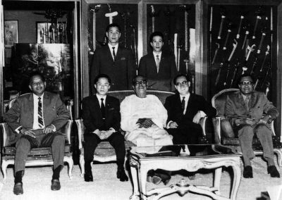 Tunku Abdul Rahman, Prime Minister of Malaysia, with Grand Master Kim Bok Man; Woo Jae Lim and General Choi Hong Hi in the Prime Minister's official residence during a visit to Malaysia in 1963. Kim Bok Man (L) and Woo Jae Lim (R) stand behind Tunku Abdul Rahman. General Choi Hong Hi sits on Tunku Abdul Rahman's right.