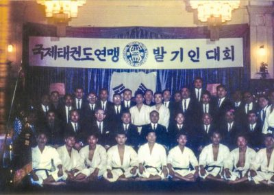 Directors and instructors pose after a demonstration as part of the Opening Ceremony for the founding of the International Taekwon-Do Federation (ITF) in the Rose Ballroom at the Chosun Hotel in Korea on Tuesday, March 22, 1966. Supreme Master Kim Bok Man is seated in the front row, left.
