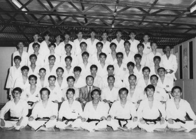 Supreme Master Kim Bok Man (second row, third from the right) poses with members of the Hong Kong Taekwon-Do Association after testing in Hong Kong, 1967. Grand Master Nam Tae Hi (in suit) sits beside Supreme Master Kim Bok Man.