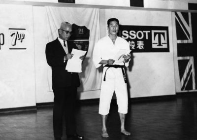 Supreme Master Kim Bok Man answers technical questions about Taekwon-Do before an hour long demonstration for members of the press by the newly-formed Hong Kong Taekwon-Do Association in the penthouse of the Shui Hing Building in Kowloon, Hong Kong, on Wednesday, January 11, 1967.
