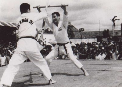 Supreme Master Kim Bok Man, Leader of the historic first ITF Demo Team, defends against a pole attack by Bong Suk Kun with a baton during a Taekwon-Do demonstration in Yogyakarta, Indonesia, January 1968.