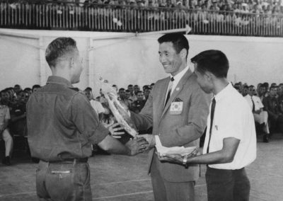 A Navy Commander presents a pennant to Supreme Master Kim Bok Man, Leader of the first International Taekwon-Do Demonstration Team, before a Taekwon-Do demonstration for Navy students in Indonesia, 1968.
