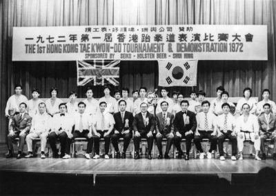 Supreme Master Kim Bok Man, organizer of the First Hong Kong Taekwon-Do Tournament and Demonstration, poses for a group photograph with the tournament board at city hall, where the event took place, in Hong Kong, 1972.