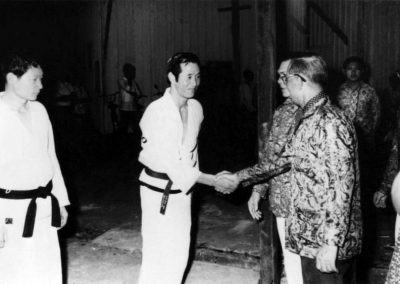 His Excellency the Governor of Sarawak, Tun Datuk Patinggi Tuanku Haji Bujang, greets Supreme Master Kim Bok Man before a Taekwon-Do performance in Malaysia, 1973.