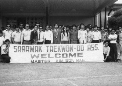 Members of the Sarawak Taekwon-Do Association welcome Supreme Master Kim Bok Man to a seminar in Sarawak, Malaysia 1973.