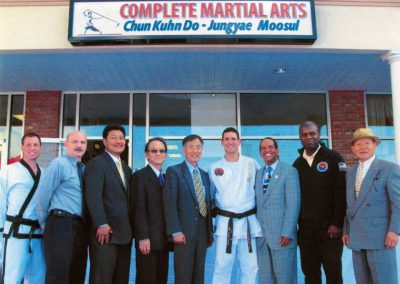 Supreme Master Kim Bok Man (fifth from the left) and Master Brad Shipp (fourth from the right) pose at the Grand Opening Celebration of Complete Martial Arts on April 28, 2009 in Roseland, New Jersey, U.S.A. Also pictured are Mr. Clint Wehner (left), instructor at Complete Martial Arts; Master Kim In Ki (third from left), President of the New York Tuk Kong Association; and Master George Vitale (second from left).