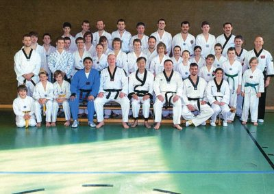 Supreme Master Kim Bok Man poses with participants of the World Chun Kuhn Do Federation seminar in Germany, March 2009.