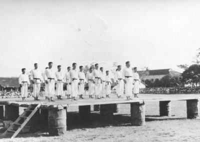 Members of the historic first Korean National Armed Forces Taekwon-Do Demonstration Team stand at attention during a demonstration in Vietnam, February, 1959. Captain Nam Tae Hi [ROK Army, Serial #210053], front and center, leads the demonstration team.