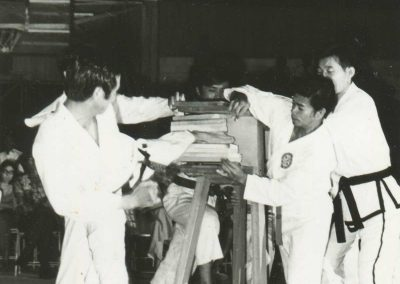 "Supreme Master Kim Bok Man breaks four pieces of 1"" board with a standing side kick during a demonstration in Sarawak, Malaysia, 1969."