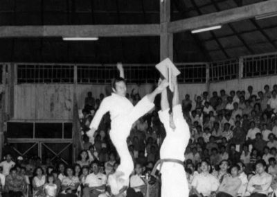 "Supreme Master Kim Bok Man breaks a 1"" board held seven feet high with a jumping turning kick during a Taekwon-Do demonstration in Sarawak, Malaysia, 1973."
