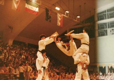 "Master Kim Won Kuk, son of Supreme Master Kim Bok Man, breaks two pieces of 1"" board with a flying high double front snap kick during a demonstration at the 3rd Asian Taekwon-Do Championships held September 8-10, 1978 at MacPherson Stadium in Hong Kong."