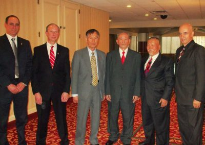 Supreme Master Kim Bok Man poses with Master Doug Cook (second from left), noted author and head instructor of Chosun Taekwondo Academy; Grand Master Kang Suh Chong (third from right), former Vice President of the International Taekwon-Do Federation (ITF) under General Choi Hong Hi; Grand Master Chung Kwang Duk (second from right), a pioneer of Taekwon-Do in Argentina and former key member of the ITF Demonstration Team under General Choi in the 1970s and 1980s; and Master Mounir Ghrawi (right), the first person from Lebanon to earn an 8th Dan from the ITF; at the Second Induction Ceremony for the Taekwondo Hall of Fame® in April 2009 in the New York metropolitan area in the United States.