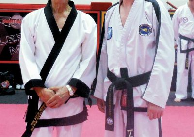 Supreme Master Kim Bok Man poses with Stuart Anslow, editor of Totally Tae Kwon Do magazine and author of several well-respected books about Ch'ang Hon Taekwon-do, after a seminar and black belt grading in Andover in the United Kingdom on May 17, 2014.