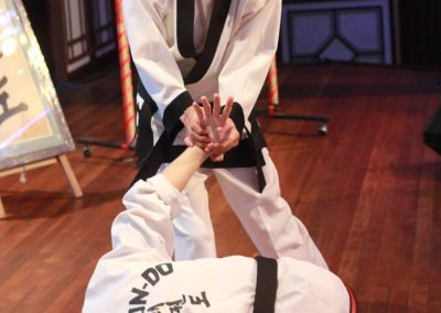 Supreme Master Bok Man Kim demonstrates a self-defense technique ending in a wrist lock of Chun Kuhn Taekwondo during a historic seminar in Malaysia in 2015.