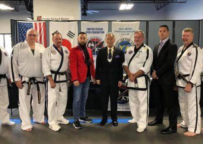 Supreme Master Bok Man Kim & Grandmaster Brad Shipp pose with instructors