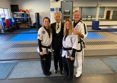 Supreme Master Kim poses with instructors during testing