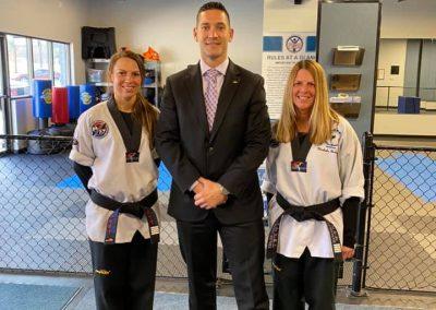 Grandmaster Brad Shipp poses with black belts during testing